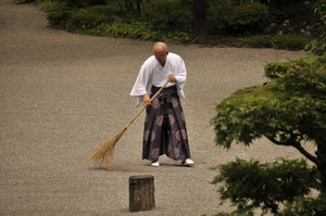 monk_sweeping_gravel_by_andyserrano